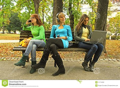 bench girls three girls on a bench royalty free stock photo image