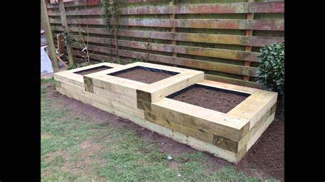 raised flower beds with the use of railway sleepers
