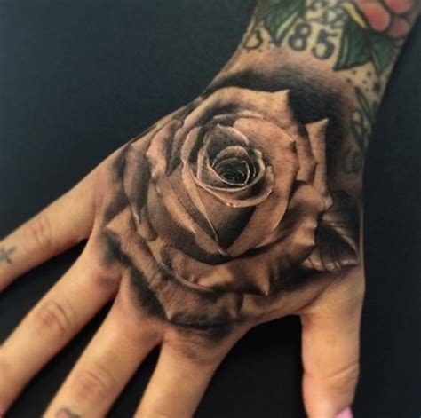 25 awesome hand tattoos and the artists behind them