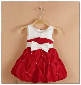 Toddler girl two years eleven months old holding red christmas