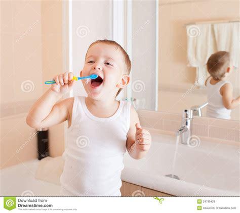 boys bathroom cleaner funny kid boy cleaning teeth in bathroom royalty free stock images image 24799429