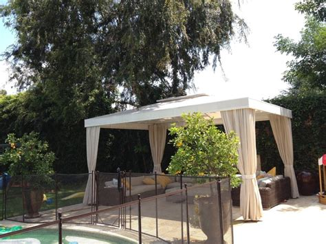 poolside white cabana with four curtains traditional