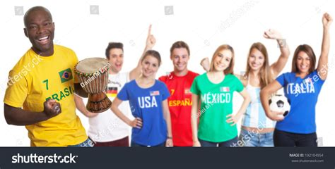 Search For In Other Countries Happy Football Fan With Drum And Fans From Other Countries Stock Photo