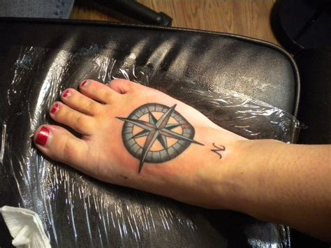small town tattoo nautical compass tattoos on foot tattoomagz