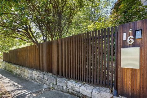 timber batten front entry fence formed gardens fence