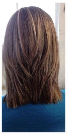 mens layered haircut for triangular triangular graduation with a low elevation and triangular