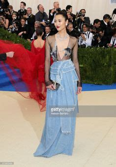 Lucky Liu At The Met Costume Gala With Zac Posen And 35 Carats Of Yellow Sapphires To Left by The Best Weirdest Most Wonderful Looks From The 2017 Met