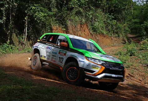 2015 mitsubishi rally mitsubishi outlander phev completes asia cross country