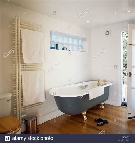 roll top bathrooms black roll top bath and wooden flooring in modern white