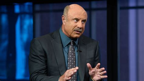 dr phil sues national enquirer spousal abuse