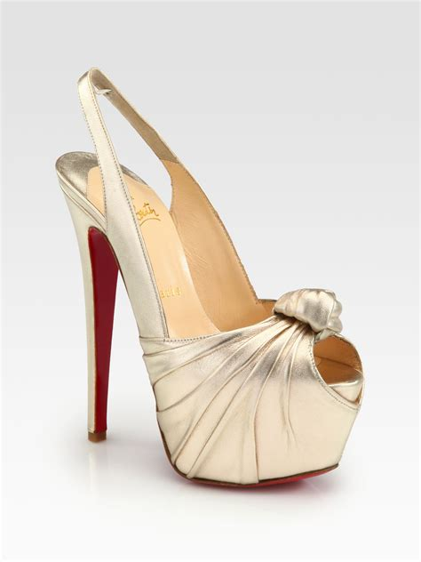 Christian Louboutins Metallic Gold Platforms by Christian Louboutin Miss Benin Metallic Leather Knot