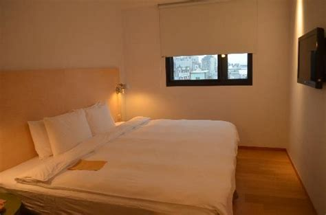 extra large bed the slippers as a souvenir picture of amba taipei ximending taipei tripadvisor