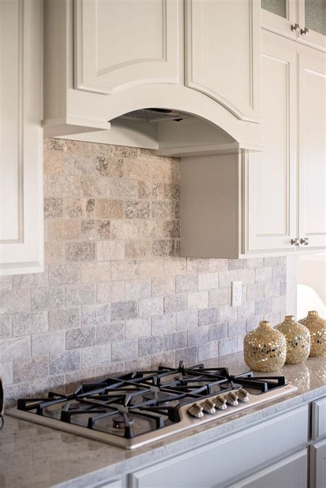 a wall subway patterned silver travertine backsplash