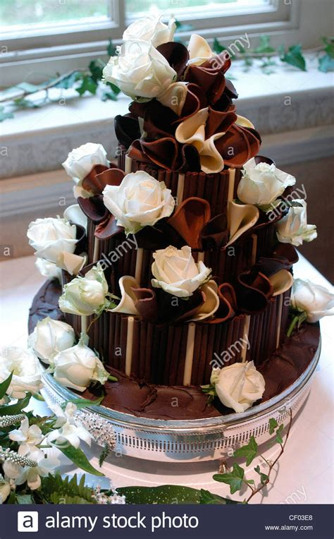 chocolate accents a three tiered dark chocolate wedding cake with white