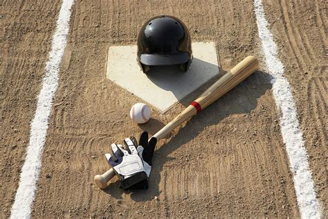 baseball bat batting gloves and baseball helmet at home