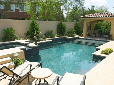 patio and pool tuscan covered patio with a pool and spa hgtv