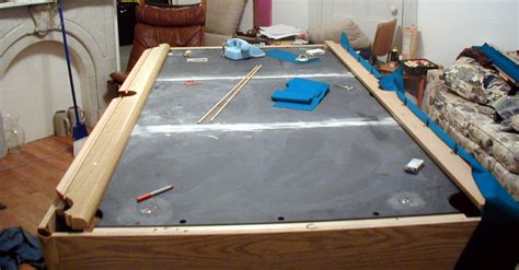 slate pool table the slate is supported by the base in a