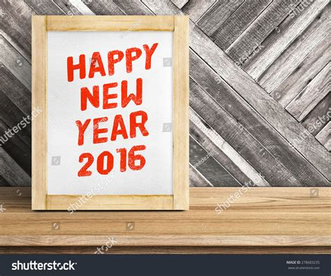 new year 2016 wood happy new year 2016 word on wood frame on table and