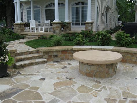 flagstone walks patio benches with covered firepit