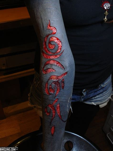 blackout tattoo process love the scarification taken out of the blacked out part