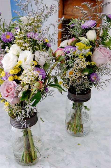 mason jar floral arrangements event planning pinterest