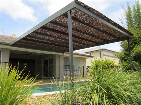 Bamboo Awning by A Queensland Patio Pool With A Bamboo Roof For