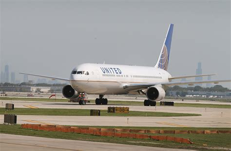 united flight united airlines to charge for overhead bin use in basic