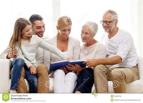 happy family with book or photo album at home stock photo