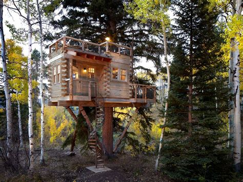 cabin outdoor lighting dazzling treehouse designs convention denver rustic exterior decorators with balcony hung