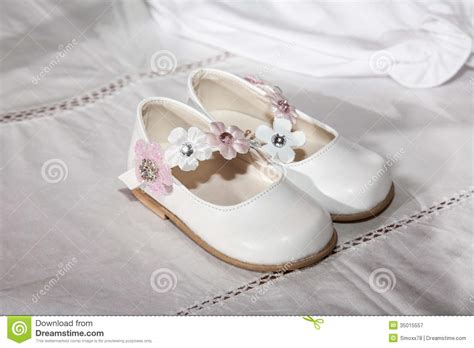 closeup of beautiful baby with flower headband stock photo baby shoes stock image image of small flowers style