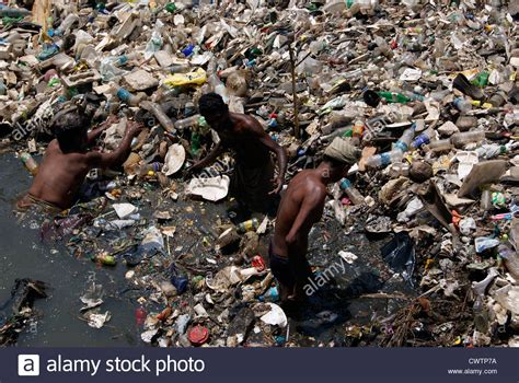 waste removal plastic and sewage waste disposal working from parvathy puthanar stock photo