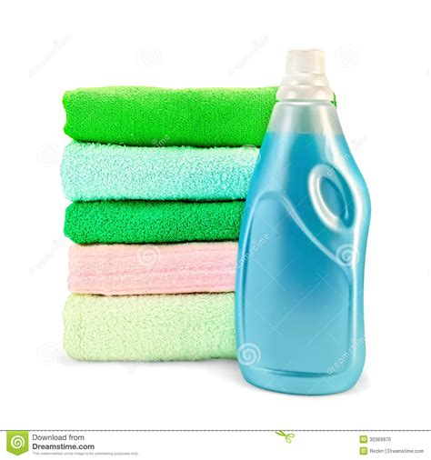 light blue shade conditioner fabric softener the bottle and a stack of towels stock