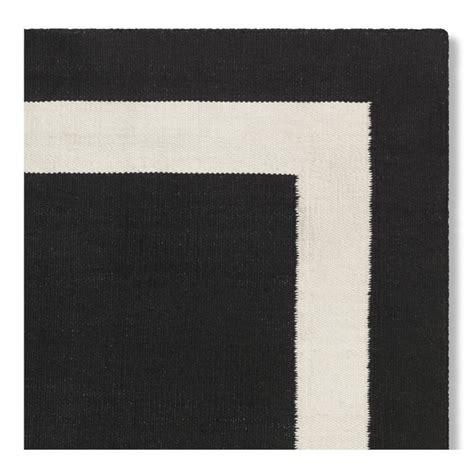 black rug with white border black border rug rugs ideas