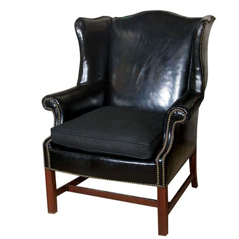 Black Leather Wingback Chair by Classic Black Leather Wing Chair With Mahogany Frame At