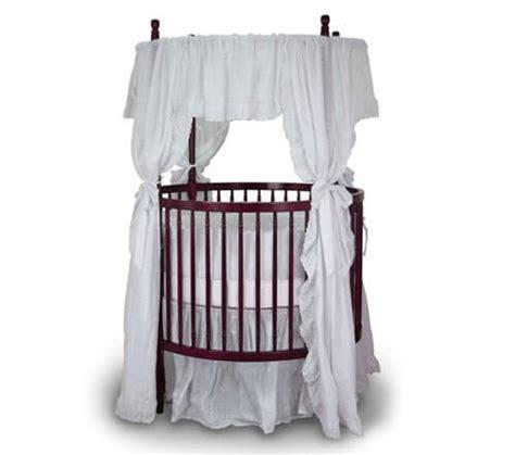 beautiful oval  baby cribs  unique nursery