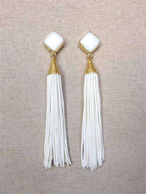 Best 25  White earrings ideas on Pinterest   White tassel earrings, Black and white earrings and