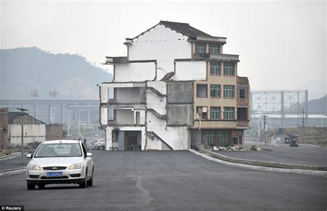 Homes On The Move road built around building as refuse to move in china daily mail