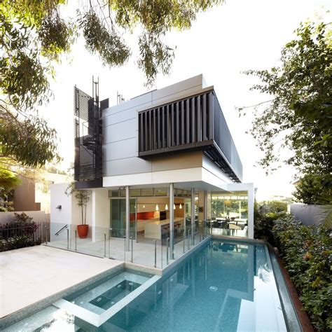 house with deck house with outdoor spiral staircase leading to rooftop deck