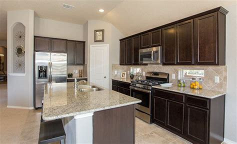 san antonio kitchen cabinets we love the tile backsplash in this kitchen from lennar