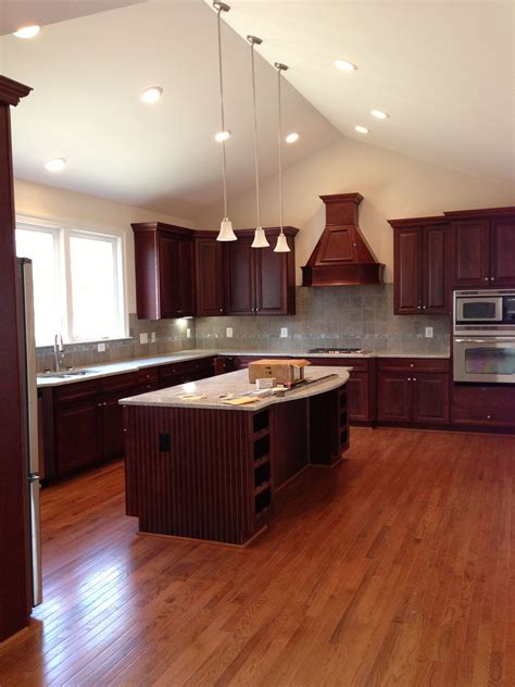 kitchen cherry cabinets  gray tile hardwood floor
