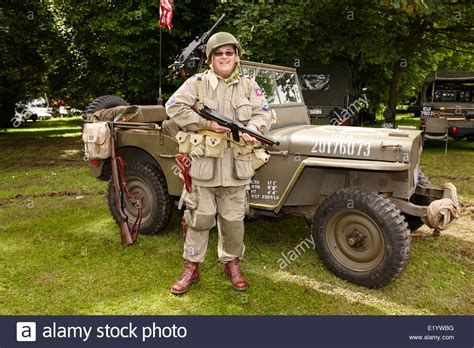 ww2 jeep front ww2 reinactor dressed as an paratrooper in front