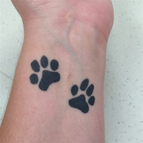 paw print wrist tattoo paw tattoos and tattoos and on
