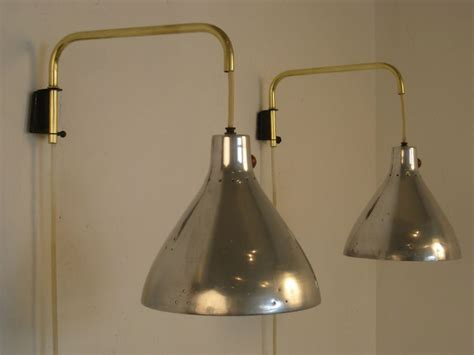 swing arm wall sconces pair of swing arm wall sconces by koch lowy at 1stdibs