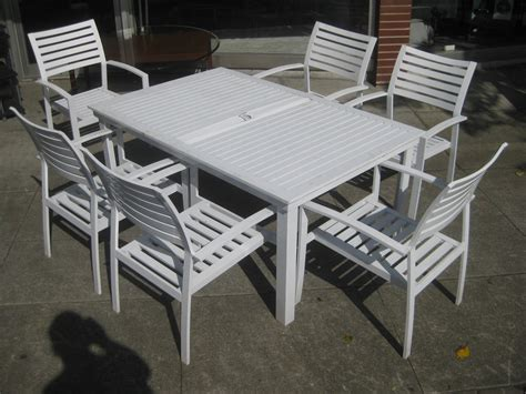 White metal garden table and chairs, clean modern office