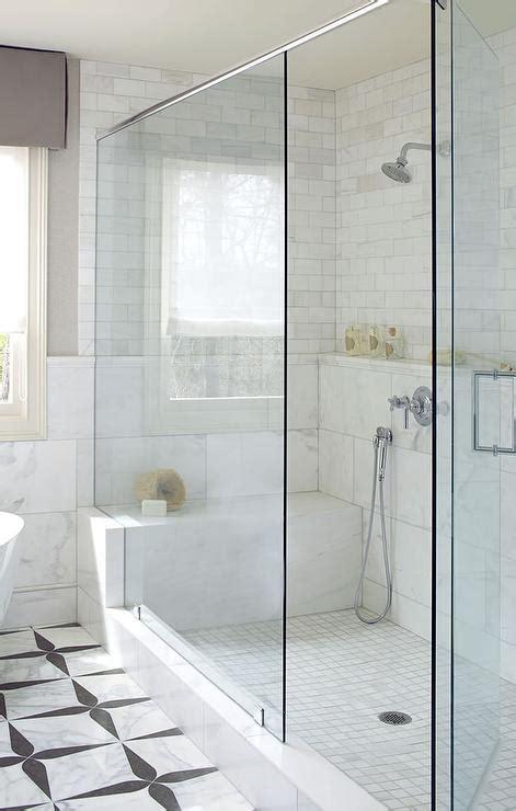 long marble shower shelf over shower bench transitional