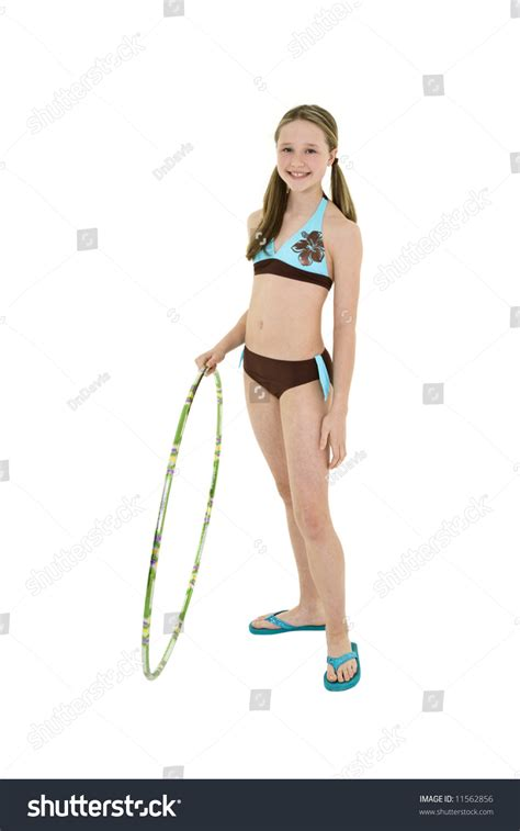 portrait preteen swimsuit holding hula hoop stock photo preteen caucasian girl standing on a white background in a