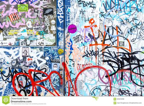 sticker and graffiti wall background editorial stock image