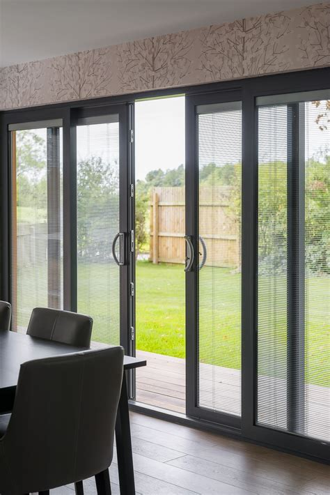 Patio Door Sliding Panels Bifold Or Sliding Patio Doors