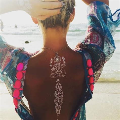 stunning white henna inspired tattoos that look like