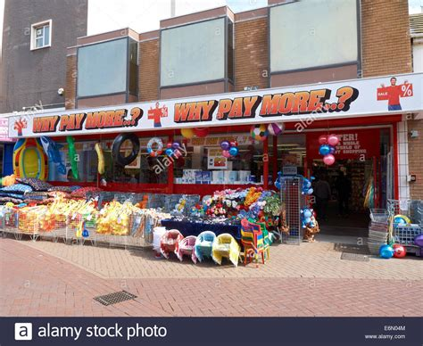 Why It To Shop In The Uk Part 1034 by Why Pay More Shop In Rhyl Wales Uk Stock Photo